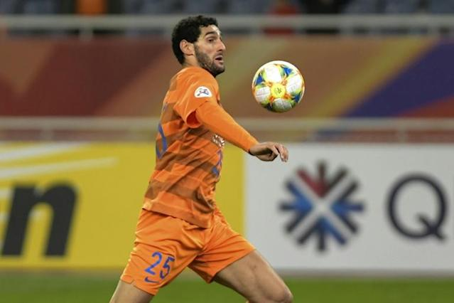 Shandong Luneng's Marouane Fellaini of Belgium is the first known coronavirus case in the CSL (AFP Photo/STR)