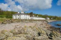 """<p>Set in Cushendun, near the Cushendun Caves, Rockport Lodge is nestled right beside the sea at the north end of the wide sandy beach, looking out to the Mull of Kintyre across the Irish Sea. There are two cottages that date back to 1813 and allow you to relax in your own garden terrace, kick back by an open fire or wonder at the ever changing seascape from the panoramic windows. Custom-made beds, hand-woven throws and organic bed linen make up some of the luxuries inside.</p><p><strong>Sleeps:</strong> 2 or 4</p><p><a class=""""link rapid-noclick-resp"""" href=""""https://go.redirectingat.com?id=127X1599956&url=https%3A%2F%2Fwww.booking.com%2Fhotel%2Fgb%2Frockport-house.en-gb.html%3Faid%3D2070929%26label%3Dbeach-house-rentals&sref=https%3A%2F%2Fwww.redonline.co.uk%2Ftravel%2Finspiration%2Fg36164603%2Fbeach-house-rentals%2F"""" rel=""""nofollow noopener"""" target=""""_blank"""" data-ylk=""""slk:CHECK AVAILABILITY"""">CHECK AVAILABILITY</a></p>"""