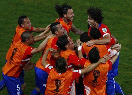 Chile's Jorge Valdivia (in red) celebrates his goal against Australia with his teammates during their 2014 World Cup Group B soccer match at the Pantanal arena in Cuiaba June 13, 2014. REUTERS/Amr Abdallah Dalsh