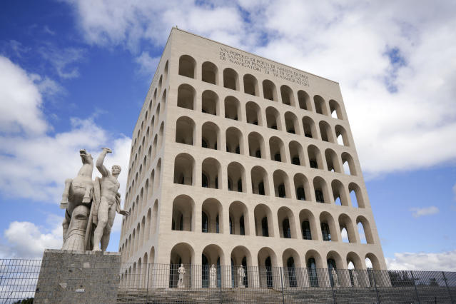 This May 6, 2019 photo shows and exterior view of the Palazzo della Civiltà' building in Rome's EUR neighborhood. Italy never went through a period that could be likened to Germany's de-Nazification. Mussolini was in power for nearly two decades before Italy entered World War II, a period of modernization during which the fascist regime built schools, railroad stations and administrative buildings in the distinctive spare architectural style that remain in public use today. (AP Photo/Andrew Medichini)