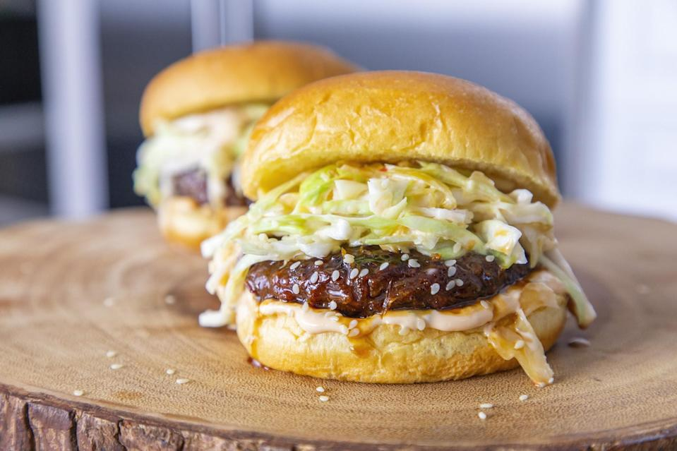 """<p>Who says <a href=""""https://www.thedailymeal.com/our-50-best-burger-recipes-gallery?referrer=yahoo&category=beauty_food&include_utm=1&utm_medium=referral&utm_source=yahoo&utm_campaign=feed"""" rel=""""nofollow noopener"""" target=""""_blank"""" data-ylk=""""slk:the best burger recipes to cook on the grill"""" class=""""link rapid-noclick-resp"""">the best burger recipes to cook on the grill</a> have to be beef? Give your plant-based burgers some Korean-inspired flavor by mixing soy sauce, ginger and sesame oil into the patties. And vegan Korean barbecue, spicy mayo and a kimchi slaw are a much-welcome upgrade from ketchup, mustard and onion.</p> <p><a href=""""https://www.thedailymeal.com/recipe/kimchi-beyond-burgers?referrer=yahoo&category=beauty_food&include_utm=1&utm_medium=referral&utm_source=yahoo&utm_campaign=feed"""" rel=""""nofollow noopener"""" target=""""_blank"""" data-ylk=""""slk:For the Kimchi Beyond Burger recipe, click here."""" class=""""link rapid-noclick-resp"""">For the Kimchi Beyond Burger recipe, click here.</a></p>"""