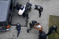 Belarusian riot police detain demonstrators during an opposition rally to protest the official presidential election results in Minsk, Belarus, Sunday, Nov. 15, 2020. Protests have rocked Belarus since the August election that official results say gave Lukashenko a sixth term in office but that opponents and some polls workers claim were manipulated. (AP Photo)