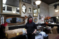 Chef Proprieter Brenda Buenviaje stands in her restaurant while interviewed at Brenda's French Soul Food in San Francisco, Wednesday, Dec. 9, 2020. In pre-pandemic days, Brenda's French Soul Food was always hopping, but everything came to a screeching halt on March 16, when San Francisco halted indoor dining to stop the spread of the coronavirus. It reopened for takeout and delivery, and Buenviaje is now shipping meals nationwide through a service called Goldbelly. (AP Photo/Jeff Chiu)