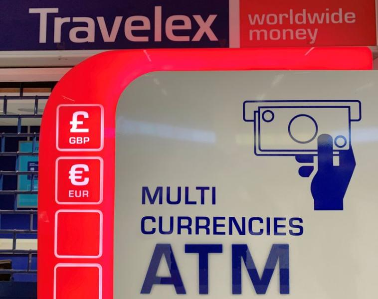 Signage is seen above a Travelex ATM at Manchester Airport in Manchester