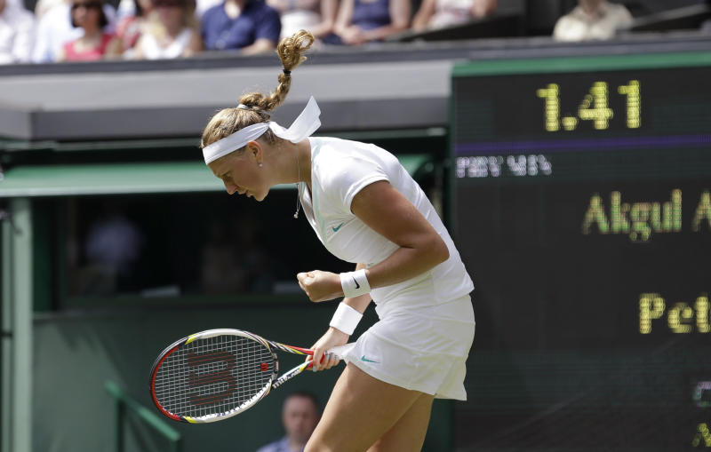 Petra Kvitova of the Czech Republic reacts during a first round women's singles match against Akgul Amanmurad of Uzbekistan at the All England Lawn Tennis Championships at Wimbledon, England, Tuesday, June 26, 2012. (AP Photo/Anja Niedringhaus)