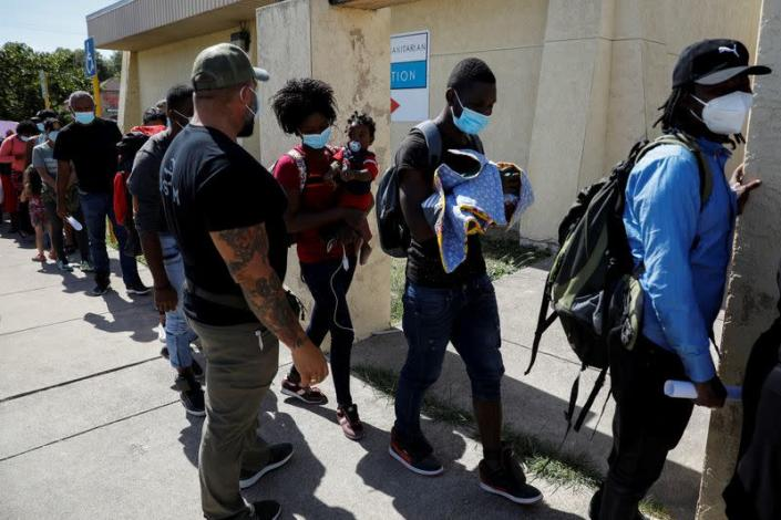 Migrants seeking asylum in the U.S. line up to board a bus to Houston from Val Verde Border Humanitarian Coalition after being released from U.S. Customs and Border Protection, in Del Rio