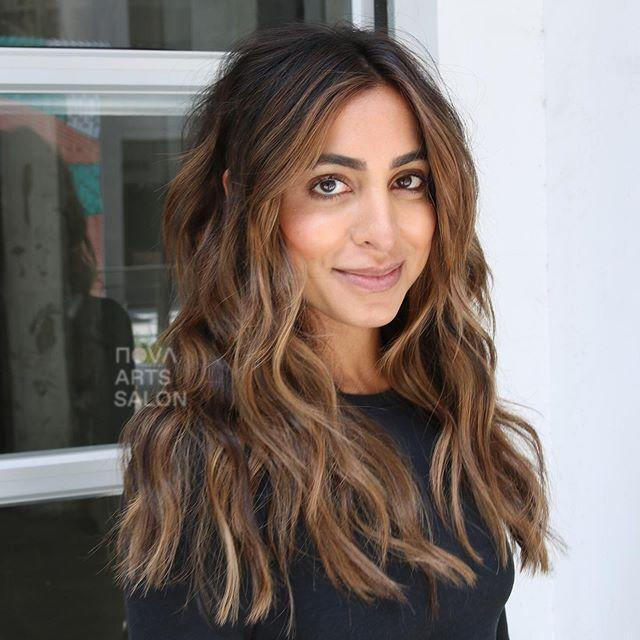 """<p>Have naturally dark brown hair? Listen up: """"Brunettes should keep an eye out for a subtle change of more neutral tones"""", says Coronado. To achieve this look, ask your colorist to paint bleach into your hair until it develops into caramel and ashy tones.</p><p><a href=""""https://www.instagram.com/p/CByIlYepOUx/?utm_source=ig_embed&utm_campaign=loading"""" rel=""""nofollow noopener"""" target=""""_blank"""" data-ylk=""""slk:See the original post on Instagram"""" class=""""link rapid-noclick-resp"""">See the original post on Instagram</a></p>"""