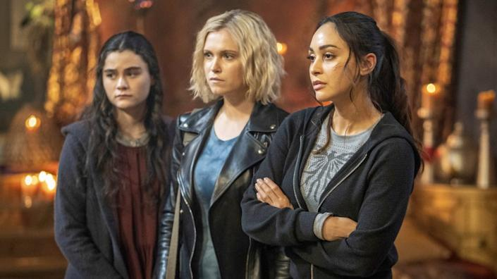 """The 100 -- The CW TV Series, The 100 -- """"Blood Giant"""" -- Image Number: HU711B_0434r.jpg -- Pictured (L-R): Lola Flanery as Madi, Eliza Taylor as Clarke and Lindsey Morgan as Raven -- Photo: Colin Bentley/The CW -- © 2020 The CW Network, LLC. All rights reserved. """"The 100"""" on The CW."""