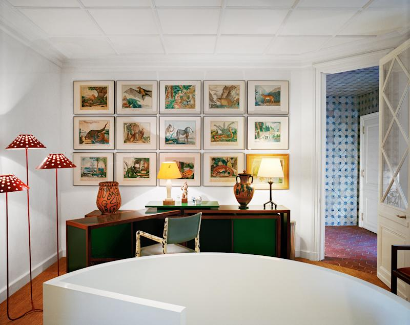 In Grange's office, A suite of Aloys Zötl watercolors hangs above the André Sornay desk. Keith Haring vase (left), Alberto Giacometti lamps. Jean Royère floor lamp.