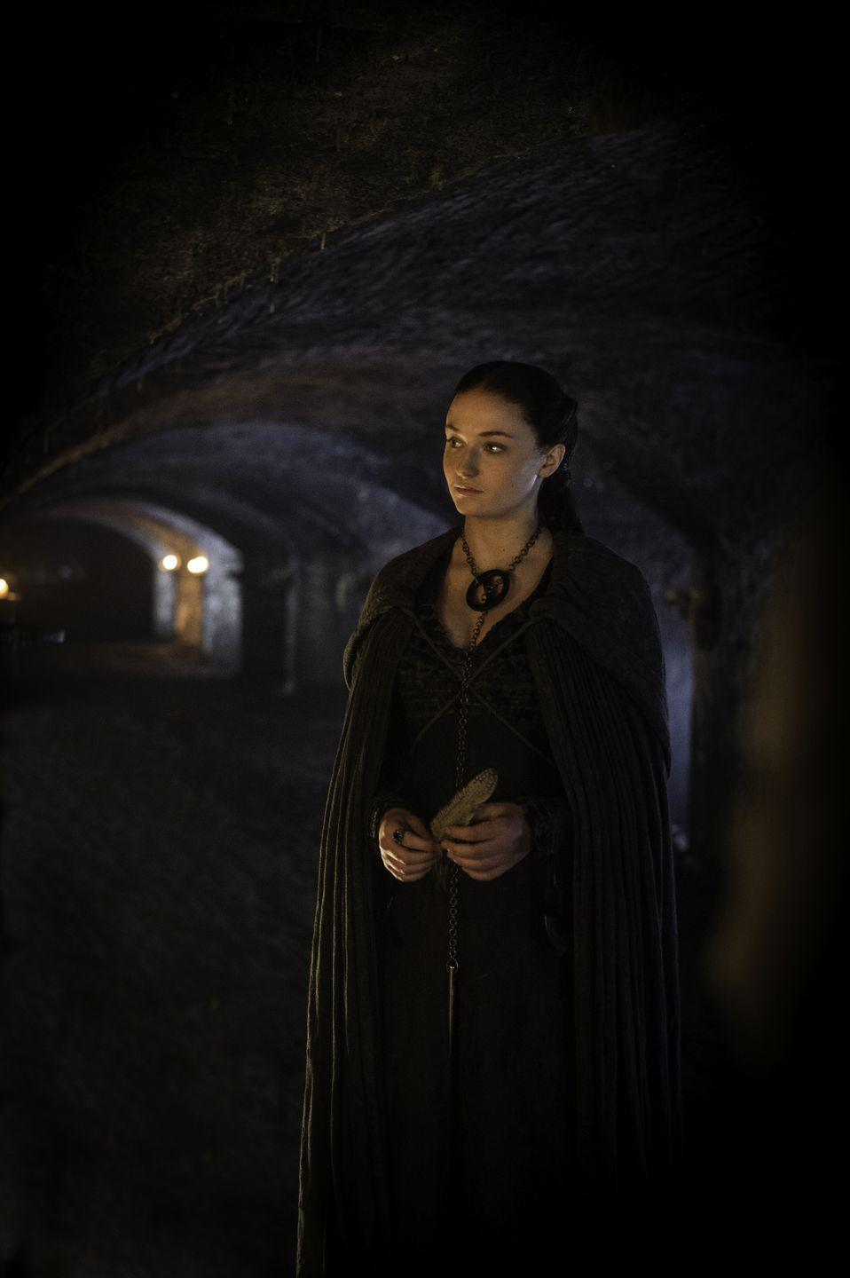 <p>When she returns to Winterfell in Season 5, Sansa maintains her dark look, but tones down her feathered shoulders, covering her dress with a cloak, as if to symbolize the loss of power she feels around the Boltons. </p>