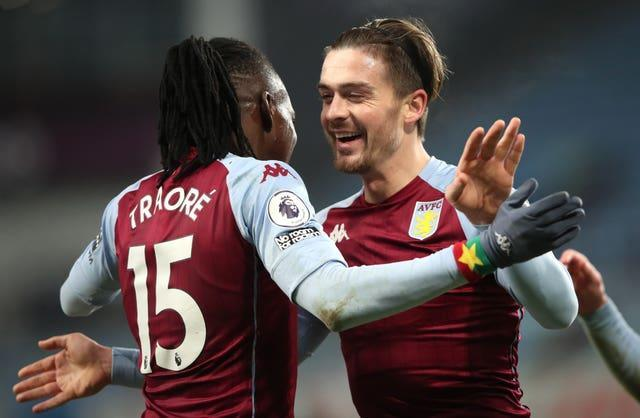 Bertrand Traore, left, combined with Jack Grealish for Villa's second goal