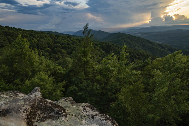 This July 2019 photo provided by The Nature Conservancy shows a sunset overlooking the rolling Appalachian mountains at Flag Rock Recreation Area in Norton, Va. The Cumberland Forest Project protects 253,000 acres of Appalachian forest in Tennessee, Kentucky, and Virginia and is one of TNC's largest-ever conservation efforts in the eastern United States. (Steven David Johnson/The Nature Conservancy via AP)