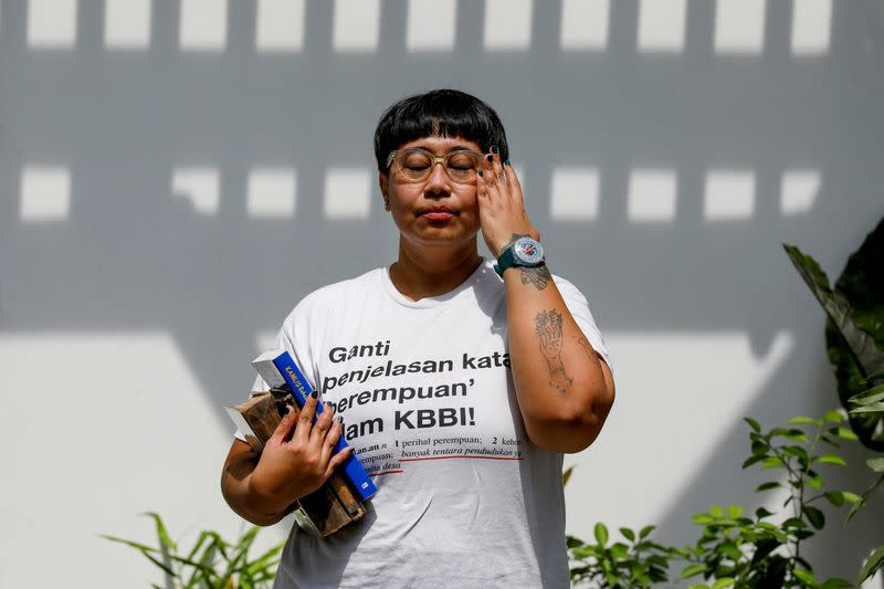 Ika Vantianti, an Indonesian artist, gestures as she poses for pictures at a cafe in Jakarta