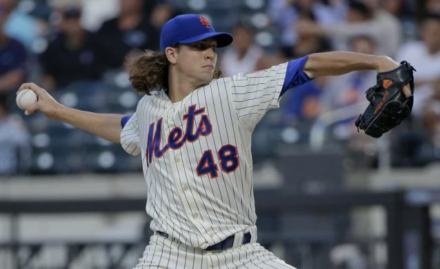 New York Mets pitcher Jacob deGrom delivers against the Atlanta Braves in the first inning of a baseball game, Tuesday, July 8, 2014, in New York. (AP Photo/Julie Jacobson)