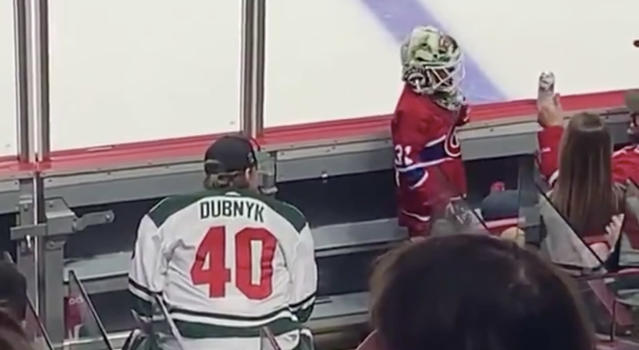 Minnesota Wild goaltender Devan Dubnyk looks on as a young Montreal Canadiens fan tries on his mask at the Bell Centre on Thursday night. (Twitter//@NHL)