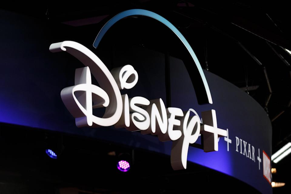 Signage for the Disney+ streaming service is displayed during the D23 Expo 2019 in Anaheim, California, U.S., on Friday, Aug. 23, 2019. Walt Disney Co. is turning the D23 Expo, the biennial fan conclave, into a big push for its new streaming services. Photographer: Patrick T. Fallon/Bloomberg via Getty Images