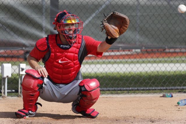 Washington Nationals catcher Kurt Suzuki catches a ball during spring training baseball practice Friday, Feb. 14, 2020, in West Palm Beach, Fla. (AP Photo/Jeff Roberson)