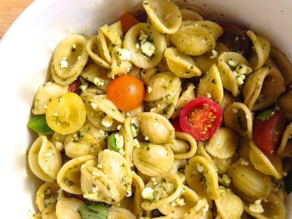 """<p>A five-ingredient pasta salad that comes together in no time.</p><p>Get the recipe from <a href=""""https://www.delish.com/cooking/recipe-ideas/recipes/a43141/pesto-feta-and-cherry-tomato-pasta-salad-recipe/"""" rel=""""nofollow noopener"""" target=""""_blank"""" data-ylk=""""slk:Delish"""" class=""""link rapid-noclick-resp"""">Delish</a>.</p>"""