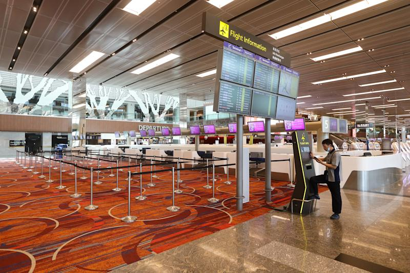 SINGAPORE - MARCH 24: A general view of an empty check in counters at Changi Airport on March 24, 2020 in Singapore. Singapore will not allow short term visitors to enter or transit through the country from March 24 to contain the spread of the imported COVID-19 infection. (Photo by Suhaimi Abdullah/Getty Images)