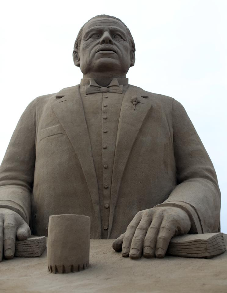 WESTON-SUPER-MARE, ENGLAND - MARCH 26:  Detail of a sand sculpture of Marlon Brando in The Godfather is seen as pieces are prepared as part of this year's Hollywood themed annual Weston-super-Mare Sand Sculpture festival on March 26, 2013 in Weston-Super-Mare, England. Due to open on Good Friday, currently twenty award winning sand sculptors from across the globe are working to create sand sculptures including Harry Potter, Marilyn Monroe and characters from the Star Wars films as part of the town's very own movie themed festival on the beach.  (Photo by Matt Cardy/Getty Images)