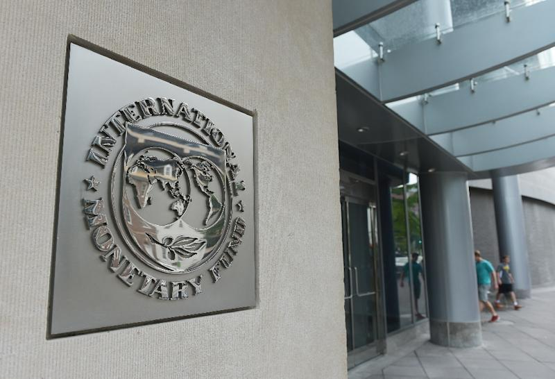 The International Monetary Fund has added a new type of aid to its toolkit, but one that involves no money, and instead solely provides a seal of approval on a government's economic reform program to help it to access private sources of financing (AFP Photo/MANDEL NGAN)