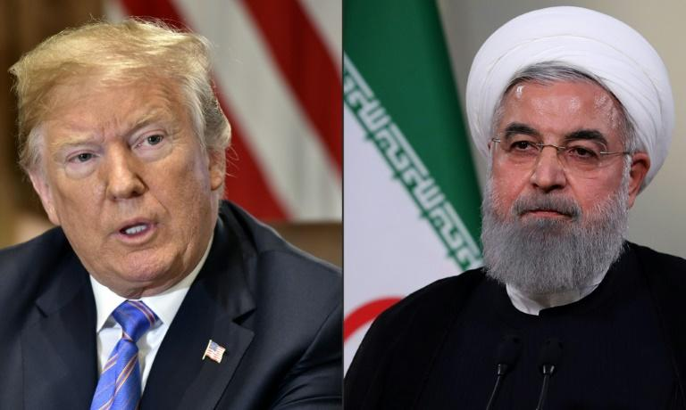 After intense European efforts to bring the two together, President Trump did get as far as phoning his Iranian counterpart but President Rouhani insisted Washington must lift sanctions first (AFP Photo/Nicholas Kamm, HO)