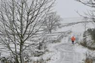 UK forecasters warned of roads becoming blocked by deep snow and disruptions to bus, rail and air travel