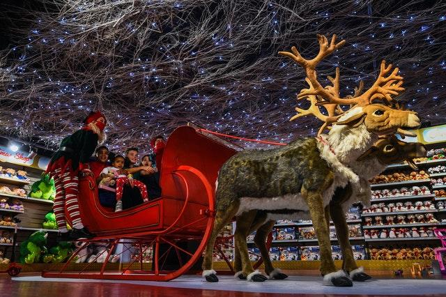 Staff and children sit in a sleigh during the Hamleys Christmas toy showcase at Hamleys, Regent Street, London