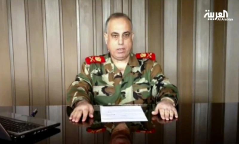 """In this image made from video broadcast on Al Arabiya TV late Tuesday, Dec. 25, 2012, Syrian Maj. Gen. Abdul-Aziz Jassem al-Shallal makes remarks saying he is joining """"the people's revolution.""""  The general who heads Syria's military police has defected and joined the uprising against President Bashar Assad's regime, one of the highest walkouts by a serving security chief during the country's 21-month uprising, a pan Arab TV station has reported.(AP Photo/Al Arabiya via AP video)TV OUT NO SALES"""