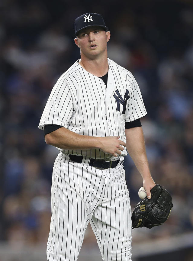 New York Yankees' Zach Britton reacts after walking Kansas City Royals' Drew Butera with the bases loaded to force in a run in the seventh inning during the second game of a double header Saturday, July 28, 2018, at Yankee Stadium in New York. (AP Photo/Rich Schultz)