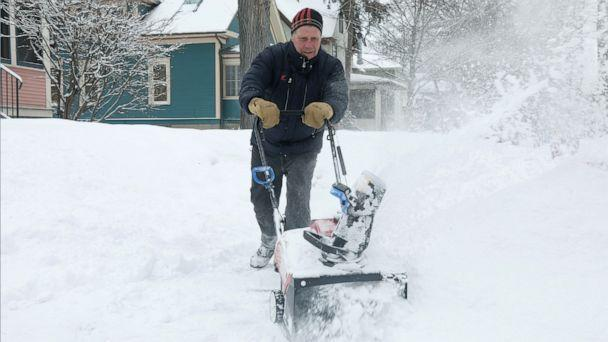 PHOTO: Bill Richardson uses a snow blower in Minneapolis, Feb. 4, 2021. (Emilie Richardson/ABC News)