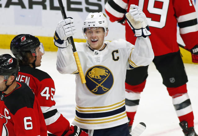 Buffalo Sabres forward Jack Eichel (9) celebrates his goal during the first period of an NHL hockey game against the New Jersey Devils, Monday, Dec. 2, 2019, in Buffalo, N.Y. (AP Photo/Jeffrey T. Barnes)