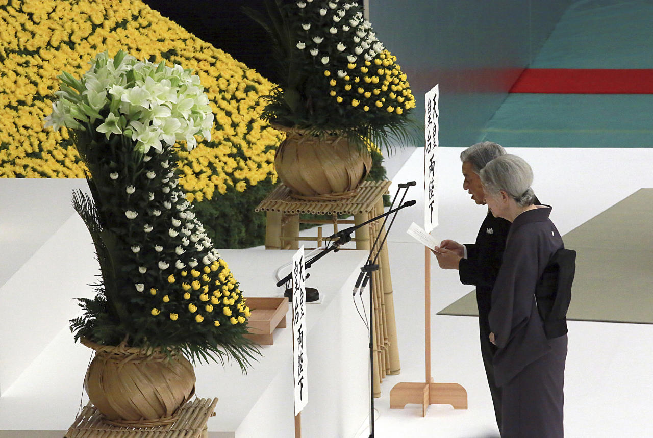 Japan's Emperor Akihito delivers his remarks with Empress Michiko during a memorial service at Nippon Budokan martial arts hall Wednesday, Aug. 15, 2018, in Tokyo. Japan marked Wednesday the 73rd anniversary of the end of World War II. (AP Photo/Eugene Hoshiko)