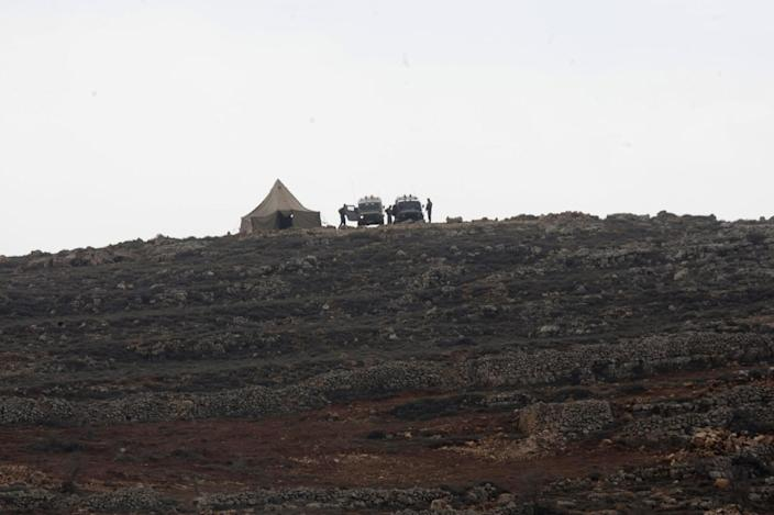 """The Israeli military places a tent near the West Bank village of Qusra, southeast of Nablus, Tuesday, Jan. 14, 2014. The annual rate of Israeli settler attacks against Palestinians has almost quadrupled in eight years, U.N. figures show, buttressing claims that Israeli security forces have largely failed to stem the so-called """"price tag"""" campaign in which thugs cut down trees, deface mosques and beat Palestinian farmers. (AP Photo/Nasser Ishtayeh)"""