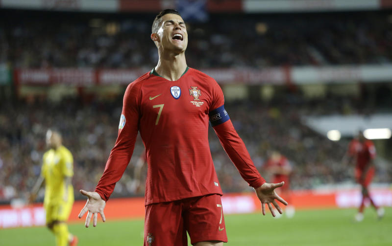 Portugal's Cristiano Ronaldo reacts after missing a scoring chance during the Euro 2020 group B qualifying soccer match between Portugal and Ukraine at the Luz stadium in Lisbon, Friday, March 22, 2019. (AP Photo/Armando Franca)
