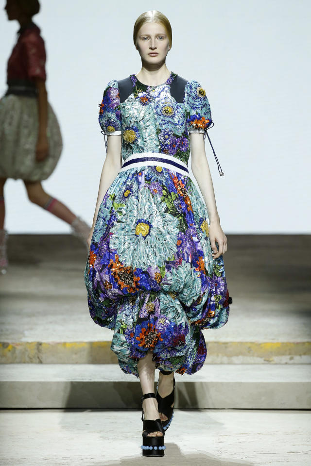 <p><i>Colorful sequined floral bubble dress from the SS18 Mary Katrantzou collection. (Photo: Getty) </i></p>