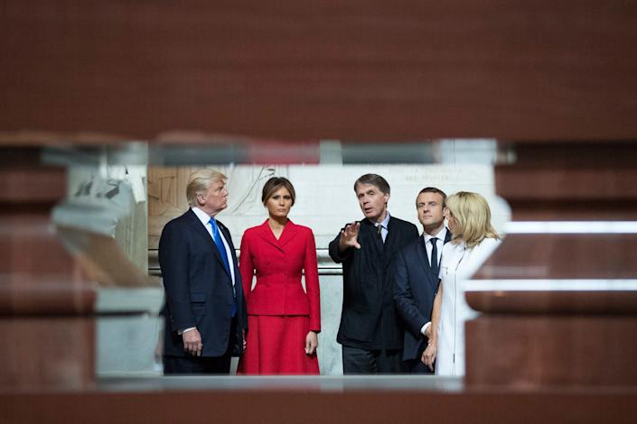 Trump, First lady Melania Trump, French President Emmanuel Macron, and his wife Brigitte Macron listen to the Director of the Army Museum, David Guillet, as they visit Napoleon Bonapartes tomb at Les Invalides in Paris, on July 13, 2017.