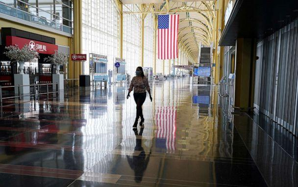 PHOTO:A woman walks through a mostly empty Reagan National airport in Washington, D.C., April 29, 2020. (Kevin Lamarque/Reuters)