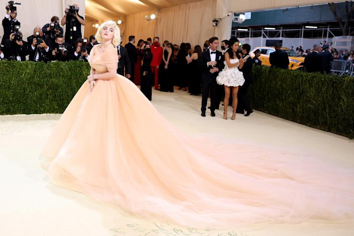 """<h2>Billie Eilish wearing Oscar de la Renta</h2><br>Billie Eilish continues her corset streak — which spans from custom Gucci bustiers on the cover of <em>British Vogue</em> and to more accessible styles by Instagram-favorite cult label Miaou — in this holiday Barbie-inspired tulle corset gown by Oscar de la Renta.<span class=""""copyright"""">Photo by John Shearer/WireImage.</span>"""