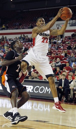 Georgia guard Gerald Robinson (22) grabs a long pass as Mercer guard Travis Smith (2) defends in the first half of an NCAA college basketball game in Athens , Ga., Tuesday, Dec. 20, 2011. (AP Photo/John Bazemore)