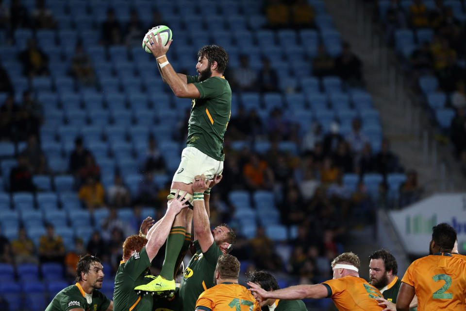 South Africa's Lood de Jager gathers a line out ball against Australia during their Rugby Championship match on Sunday, Sept. 12, 2021, Gold Coast, Australia. (AP Photo/Tertius Pickard)