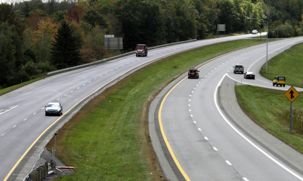Motorists are seen cruising both northbound and southbound on I-95 near the Old Town, Maine, exit on Wednesday, Sept. 28, 2011. Next week motorists traveling north from Old Town will be permitted to drive faster when the speed limit becomes 75 mph, the fastest in New England. Maine's Transportation Department will post 75 mph speed limits from Old Town to Houlton. (AP Photo/Pat Wellenbach)