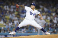 Los Angeles Dodgers relief pitcher Julio Urias (7) throws during the first inning of a baseball game against the Milwaukee Brewers Saturday, Oct. 2, 2021, in Los Angeles. (AP Photo/Ashley Landis)