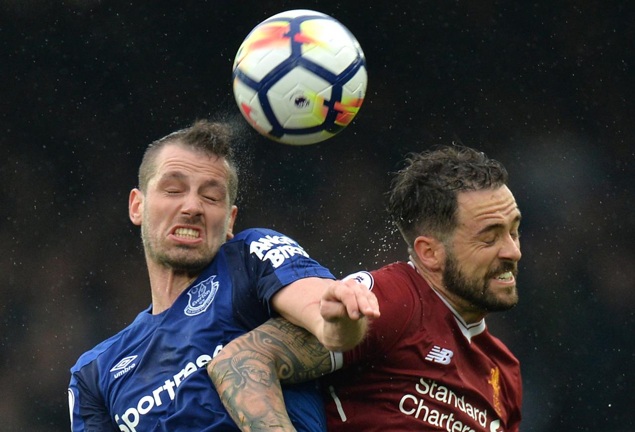 <p>Liverpool's Danny Ings plays head tennis with Morgan Schneiderlin </p>