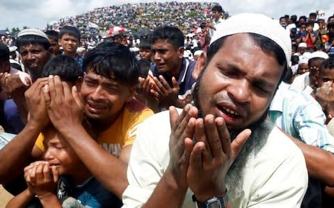 <span>Rohingya refugees take part in a prayer as they gather to mark the second anniversary of the exodus at the Kutupalong camp in Cox's Bazaar</span> <span>Credit: Reuters </span>