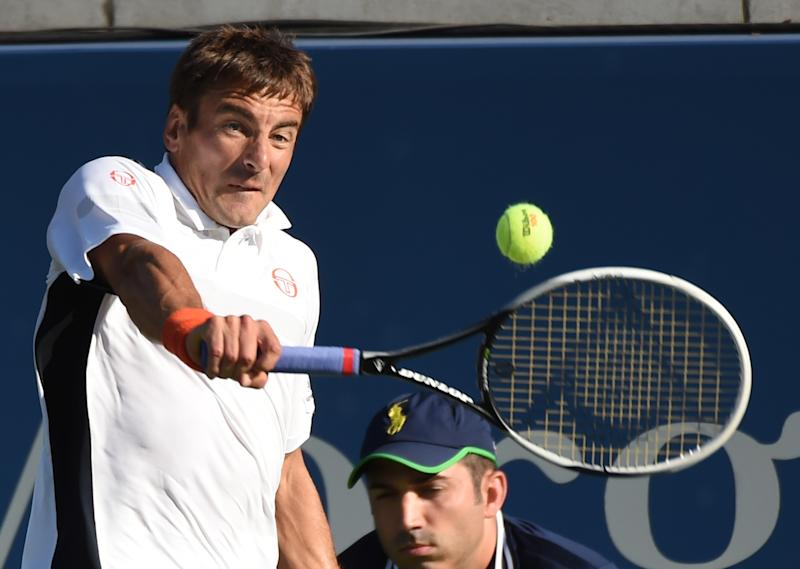 Tommy Robredo from Spain plays Simone Bolelli from Italy during their 2014 US Open men's singles match in New York, August 28, 2014