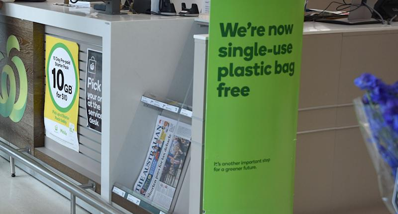 A Woolworths sign declaring 'we're now single-use-plastic bag free'. A spokesperson for the supermarket said the customer's paper bag error was due to a rare mistake by a personal shopper.