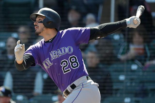"Few players in fantasy drafts have delivered an investment return the way <a class=""link rapid-noclick-resp"" href=""/mlb/players/9105/"" data-ylk=""slk:Nolan Arenado"">Nolan Arenado</a> has. (AP Photo/Chris Carlson)"