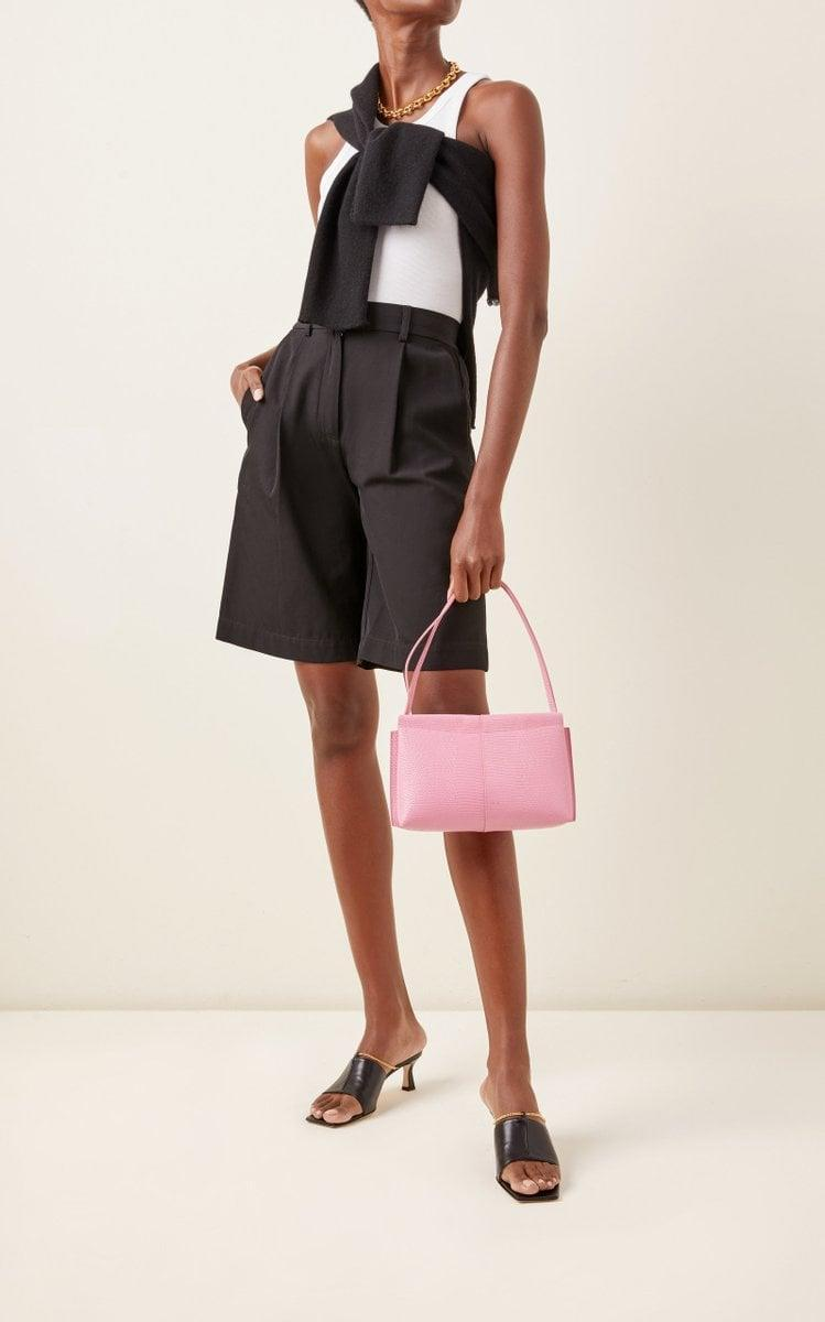 <p>This cute pink <span>Wandler Carly Mini Lizard-Effect Leather Shoulder Bag</span> ($490) is practical and adds a fun pop of color.</p>