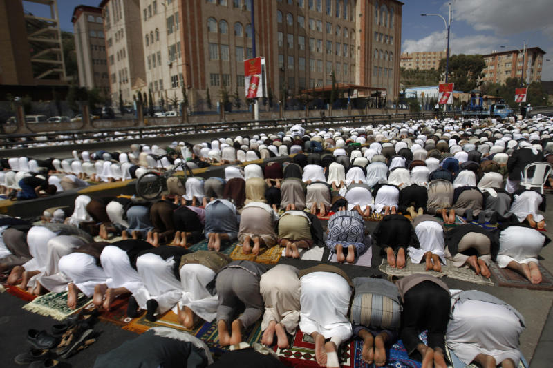 Yemeni pro-democracy protestors pray during a rally in Sanaa, Yemen, Friday, Dec. 28, 2012. (AP Photo/Hani Mohammed)